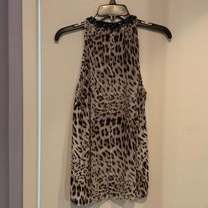 Jennifer Lopez leopard print sleeveless blouse